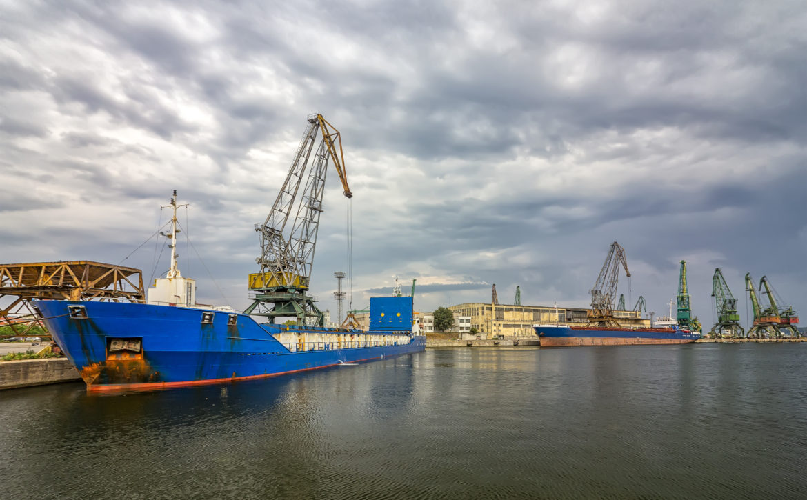 Loading raw materials with the crane to the warehouse on the trading ship of the port city, Varna, Bulgaria