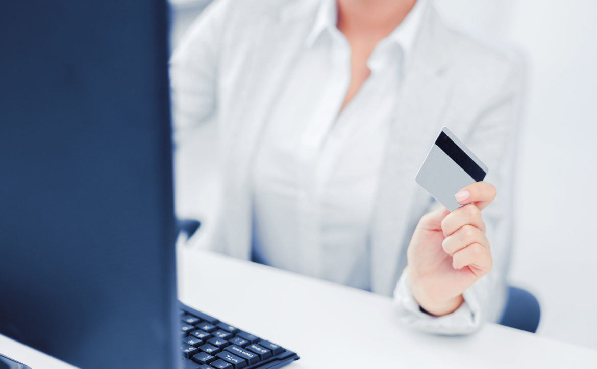 businesswoman with laptop and credit card
